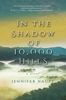 In the shadow of 10,000 hills [Playaway] : a novel